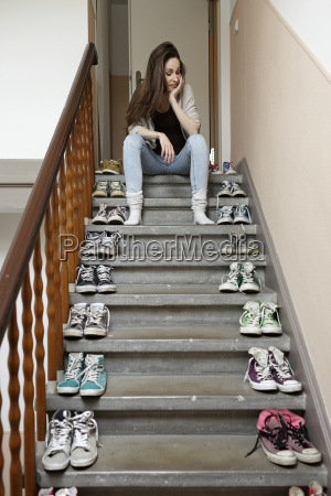 young woman sitting on staircase with