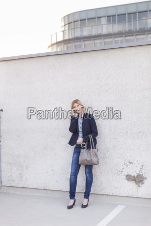 smiling blond businesswoman on the phone