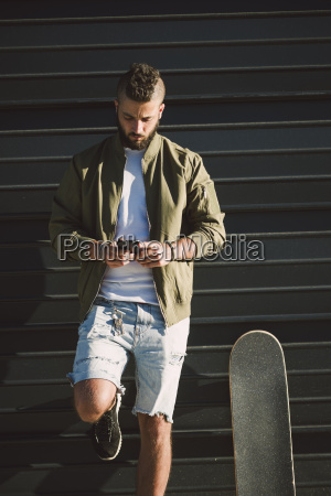 man with skateboard standing in front