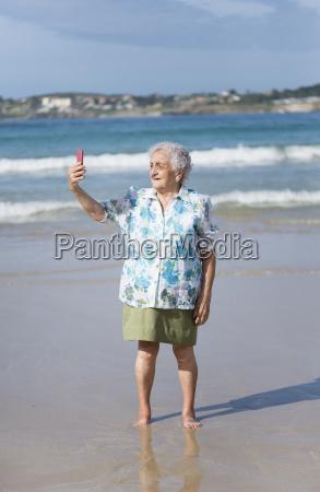 senior woman taking selfie on the