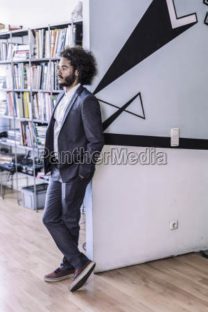 young creative businessman standing in office