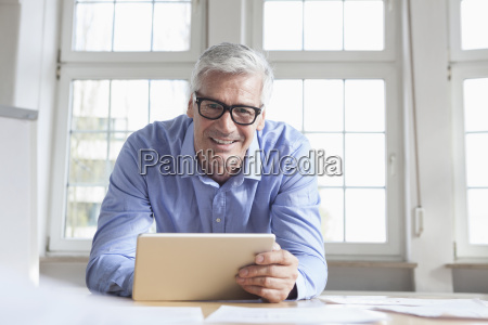 portrait of smiling mature businessman at
