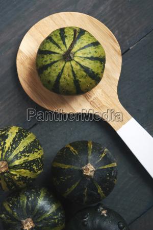 ornamental pumpkins and wooden spoon