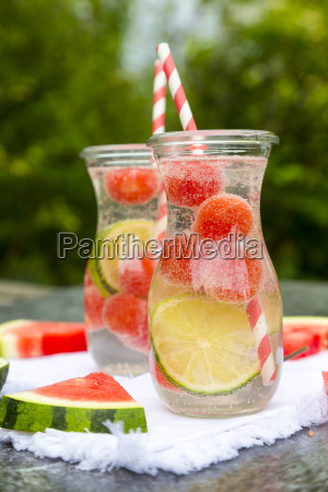 two carafes of infused water with