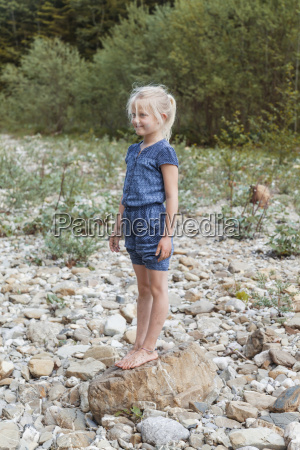 smiling little girl standing on a