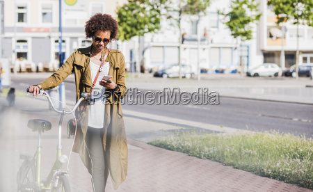 young woman looking at her smartphone