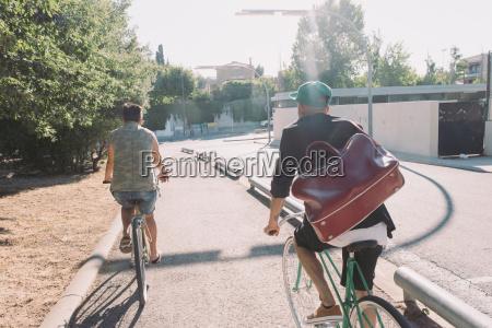 two men riding bike