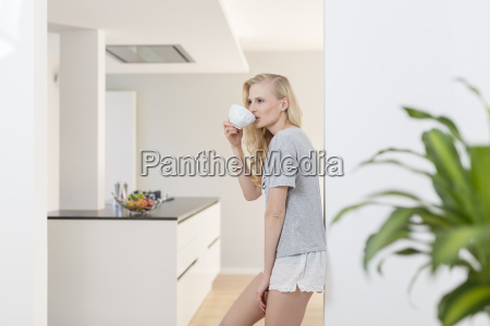 woman drinking cup of coffee in
