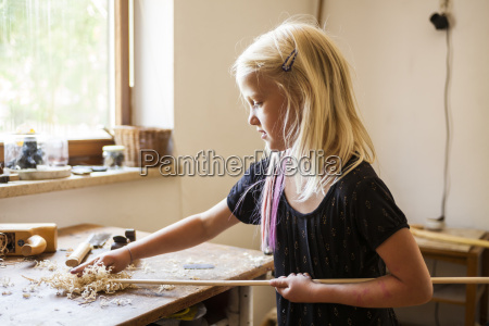 girl in workshop working on stone