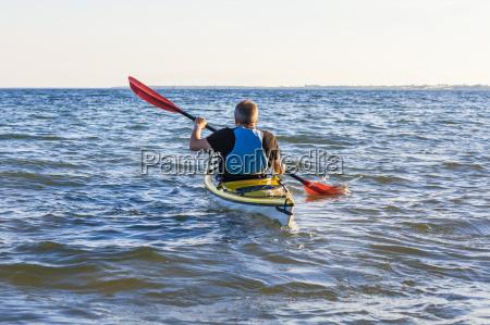denmark senior man paddling kayak