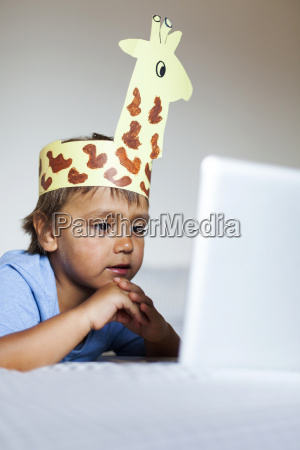 little boywith self made headdress lying