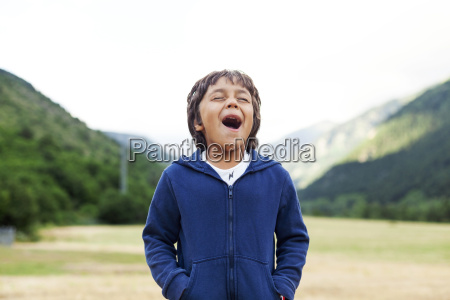 little boy in nature screaming out