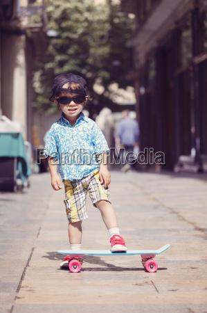 portrait of little boy with skateboard
