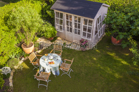 garden shed and laid table in