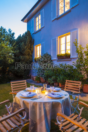 laid table in garden in the