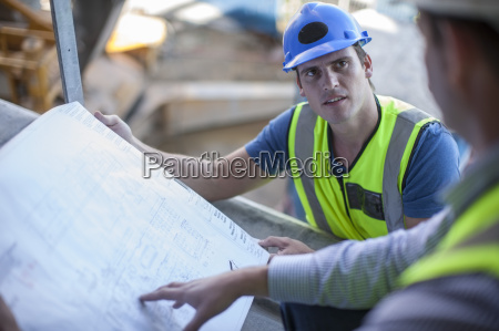 two men on construction site discussing