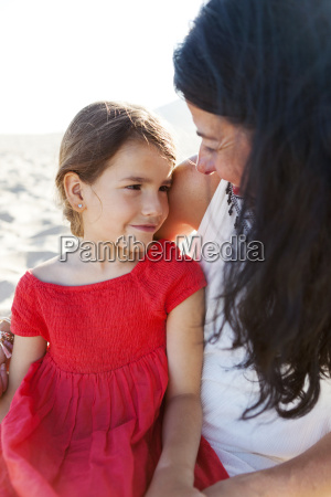 mother and little daughter together on