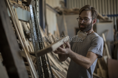 carpenter looking at a piece of