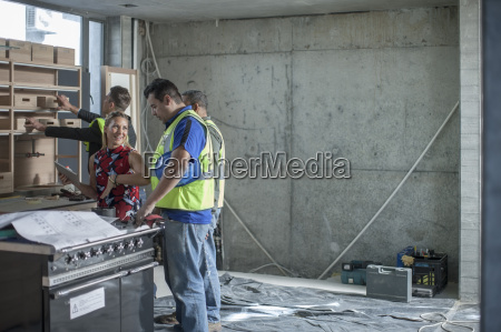 woman talking to construction worker