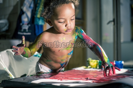 girl draws red picture with fingercolors