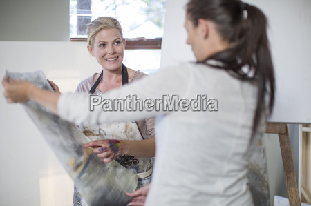 female painter showing painting
