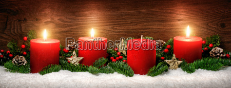 advent decoration with three candle flames