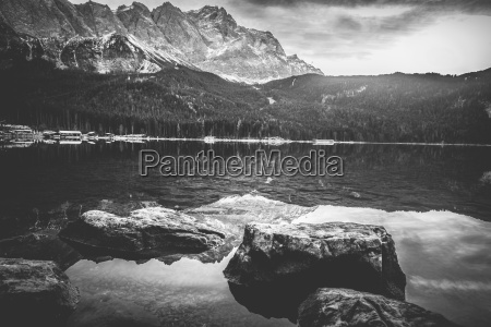 monochrome landscape with mountains reflected in