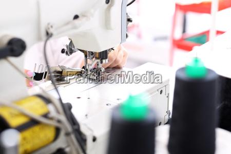 sewing seamstress at the machine clothing