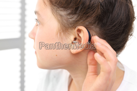 a child with a hearing aid