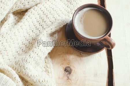 soft white knitted sweater and cup