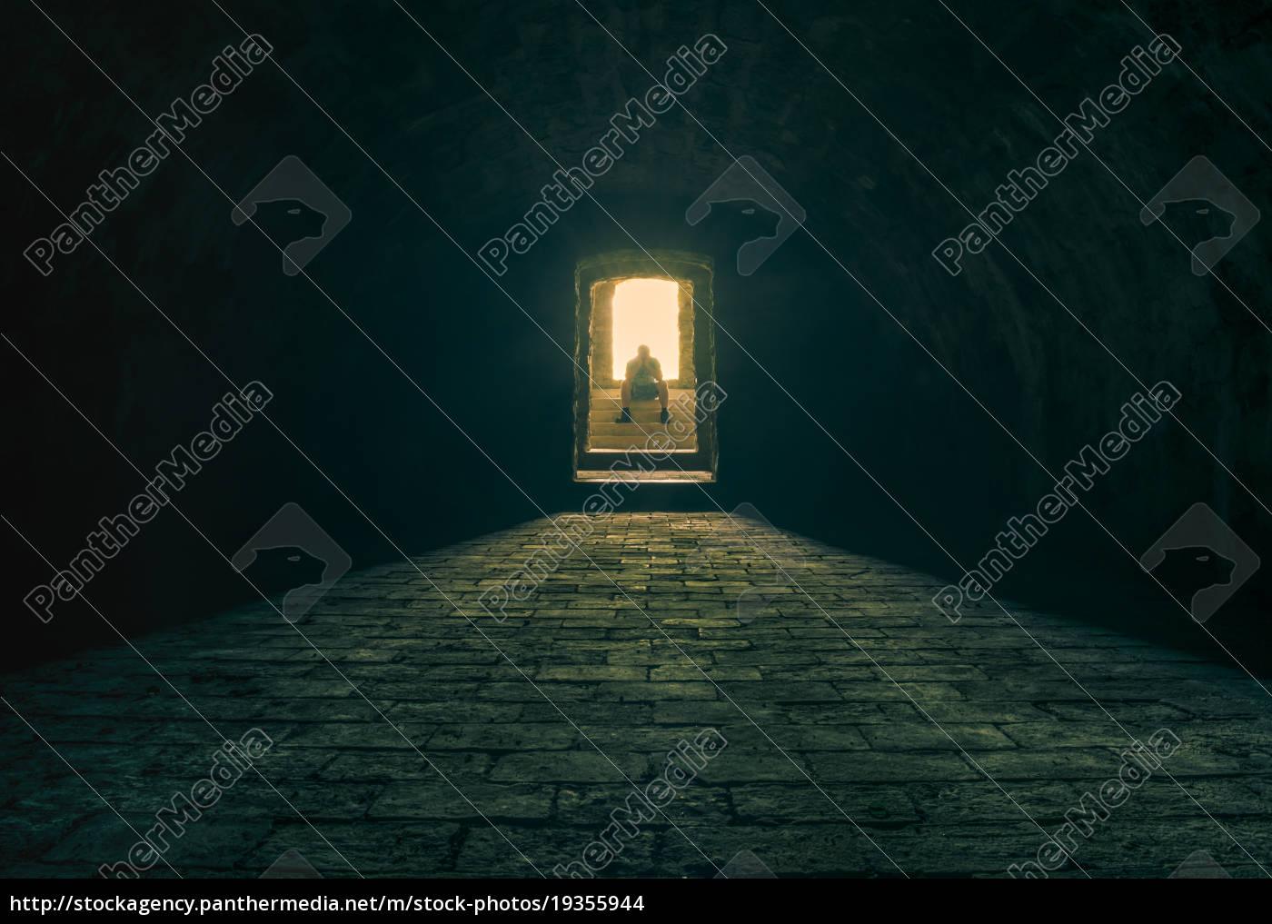 man, meditating, on, basement, stairs - 19355944