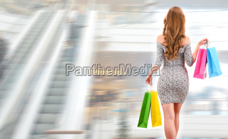 young woman with shopping bags in