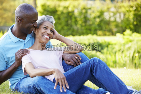 romantic mature couple sitting in garden