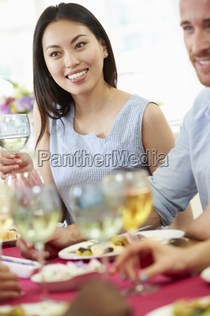 young couple relaxing at dinner party