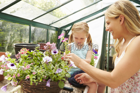 mother and daughter growing plants in