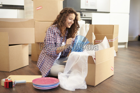 woman moving into new home and