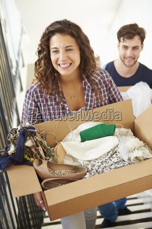 couple moving into new home carrying