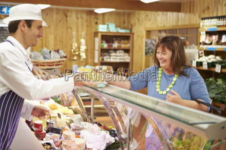 male sales assistant serving customer in