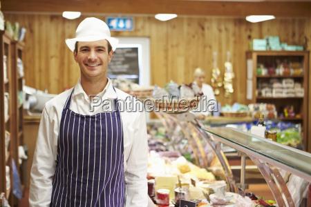 male sales assistant in delicatessen