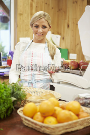 female sales assistant at checkout of