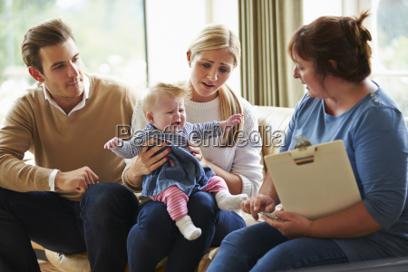 social worker visiting family with young