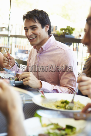 man enjoying meal at outdoor restaurant