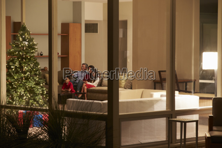 family watching christmas tv at home