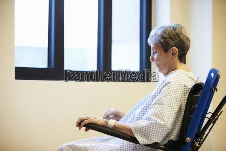 senior female patient sitting alone in
