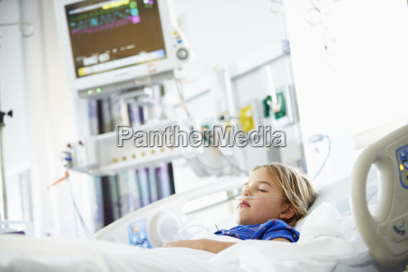 young girl sleeping in intensive care