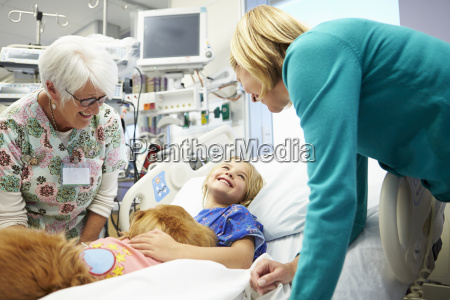 young girl being visited in hospital