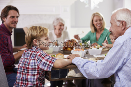 extended family group sit around table
