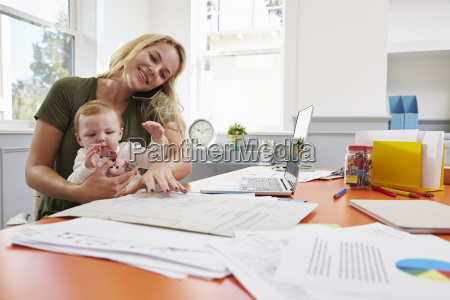 busy mother with baby running business