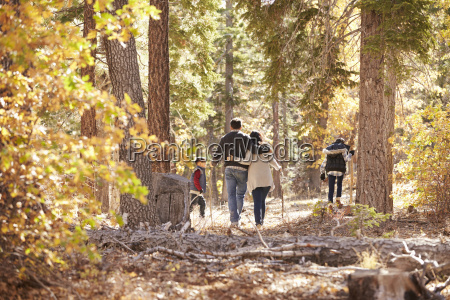 mother father and two children hiking