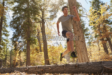 young adult man running in a